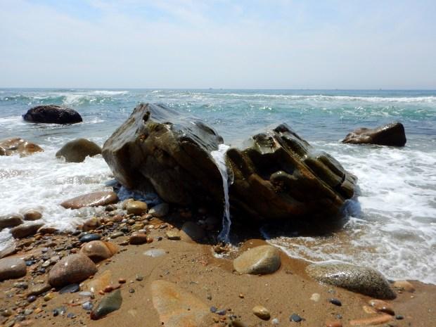 Surf spilling over rock, Mohegan Bluffs, Block Island, Rhode Island
