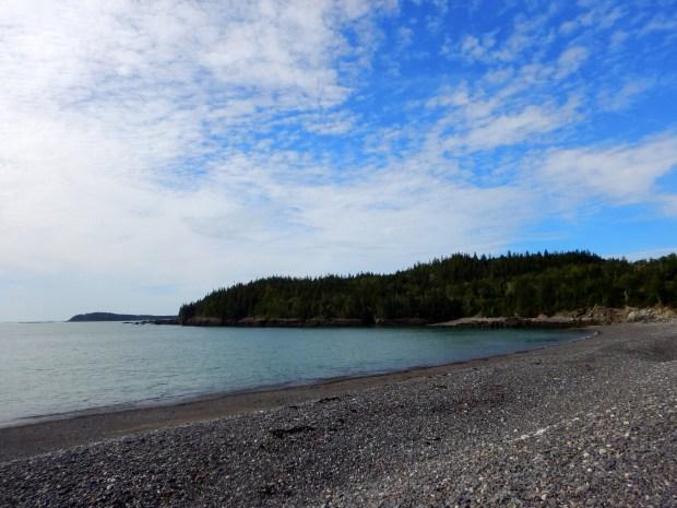 Listening to the waves tumble the rhyolite on Jasper Beach, Machiasport, Maine