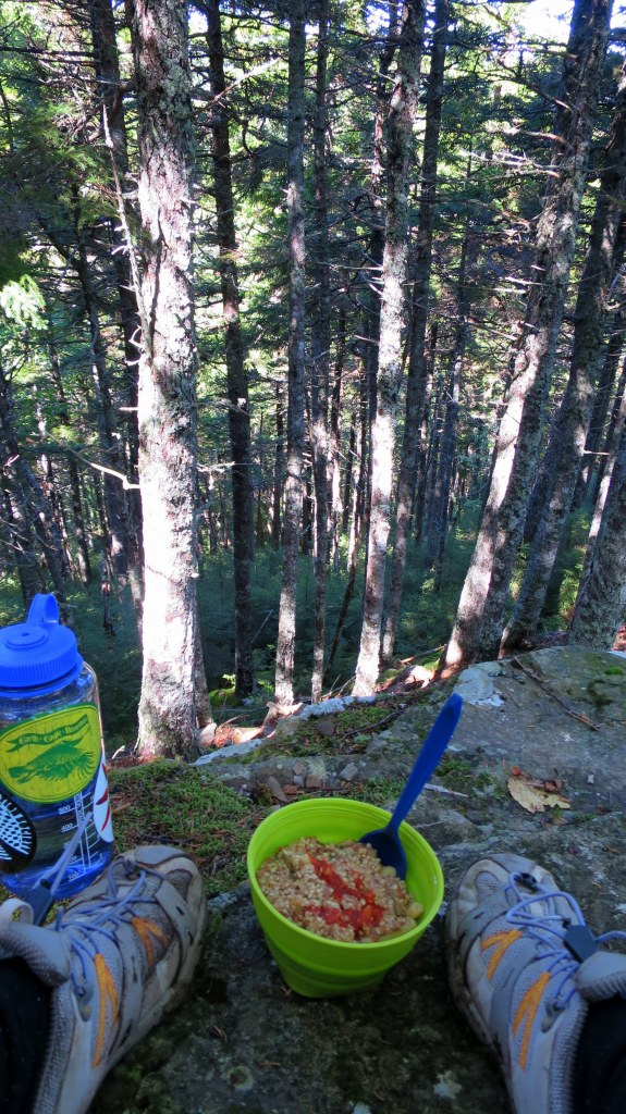 Lunch on a ledge, Coastal Trail, Fundy National Park, New Brunswick, Canada