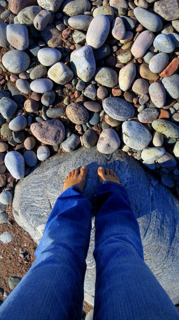 Looking at rocks, Pleasant Cove, Nova Scotia, Canada