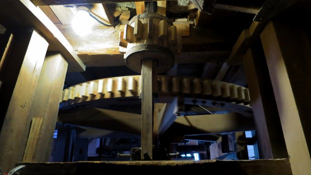 Spinning spur wheel in basement, Balmoral Grist Mill, Nova Scotia, Canada