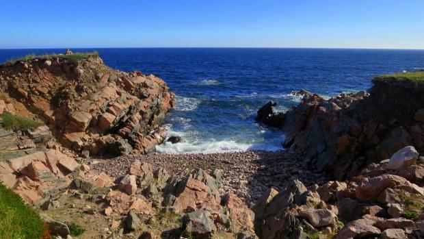Gneiss and schist under the sod, White Point, Cape Breton Island, Nova Scotia, Canada