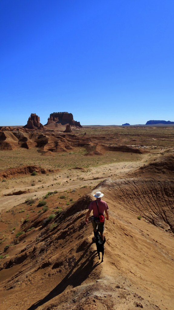 Tom and Abby walking a ridge, Goblin Valley State Park, Utah