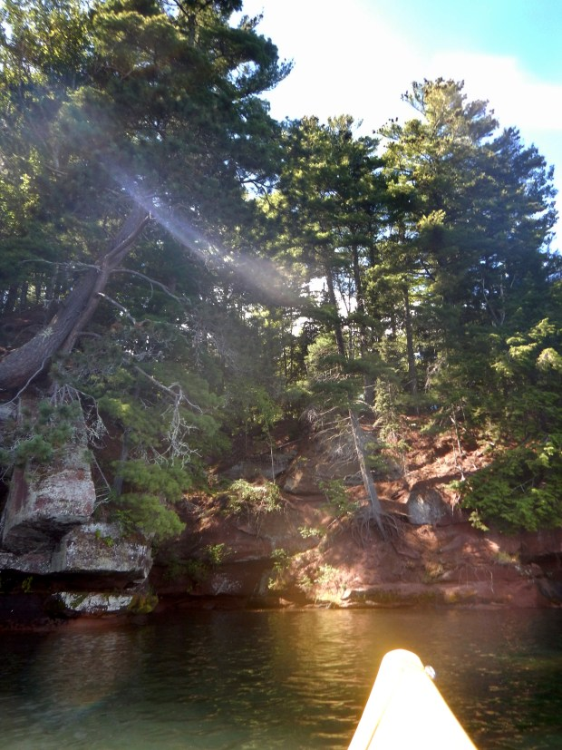 Sun coming over the cliffs, Red Cliff Indian Reservation, Wisconsin
