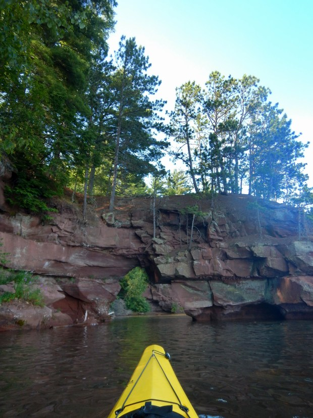 Kayaking towards an arch, Red Cliff Indian Reservation, Wisconsin