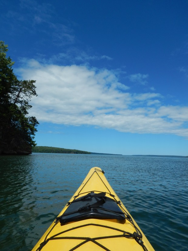 Paddling along shore of the Red Cliff Indian Reservation, Wisconsin