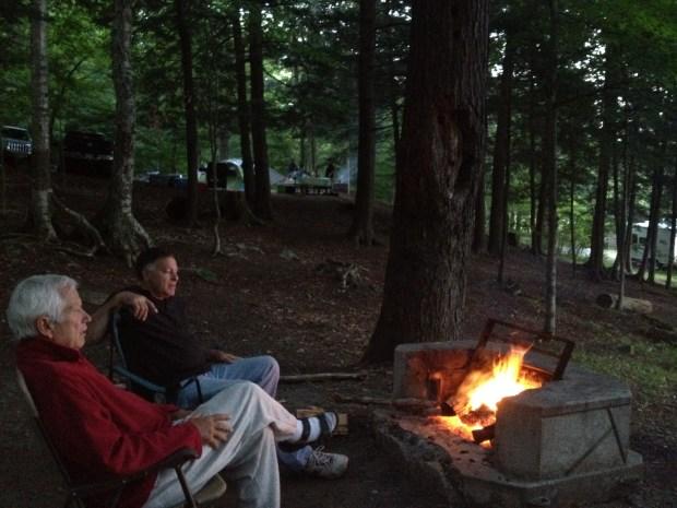 My two favorite guys sitting around the campfire, Moffitt Beach, New York