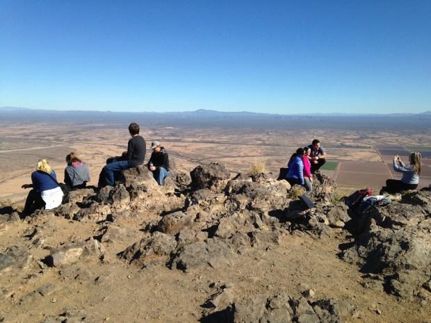 Tom's photo of people sitting and snacking on the peak, Picacho Peak State Park, Arizona