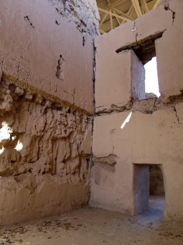 Peeking through window of Great House, Casa Grande Ruins National Monument, Arizona