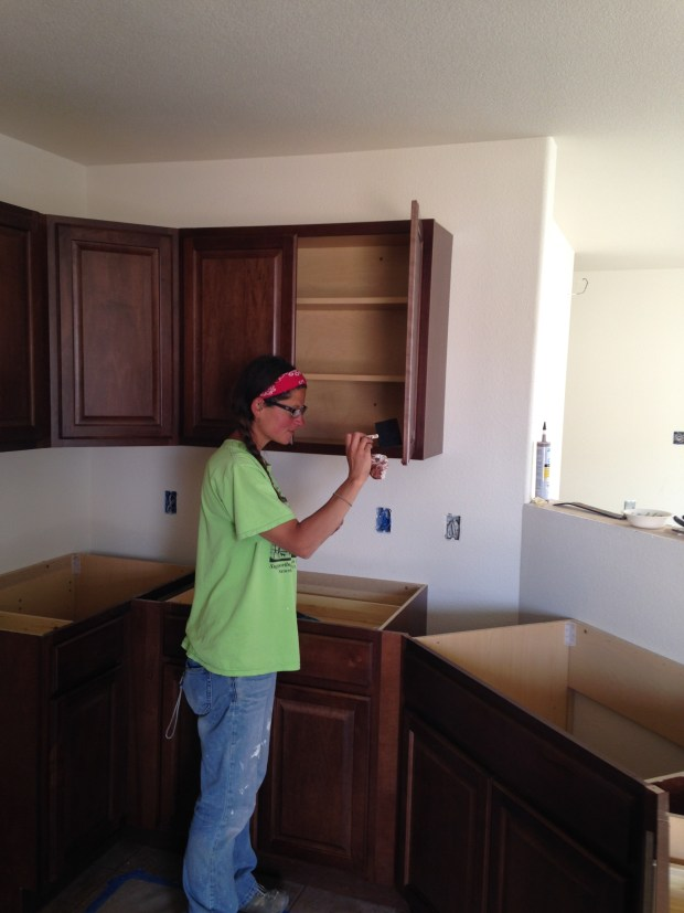 Me touching up cabinets with stain, Mesilla Valley Habitat for Humanity, Las Cruces, New Mexico