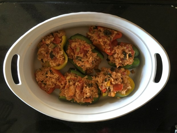 Stuffed garden peppers with tempeh, roasted tomatoes, and kale