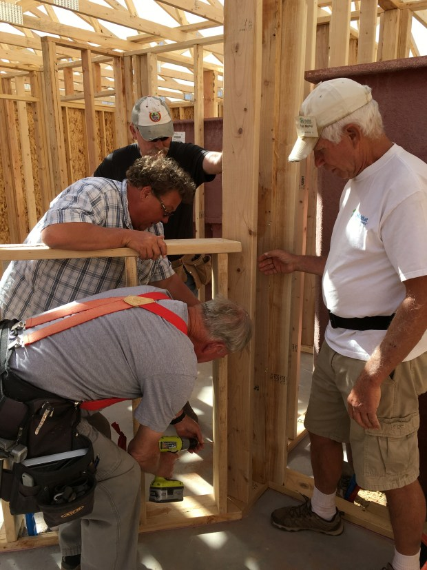 Rick, Dyana, and Tom trying to persuade the wall to stay while Jerry screws in the angle