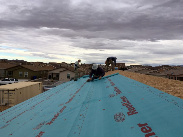 Tony, Kit, Rick, Tom and I trying to paper the roof before the wind picked up