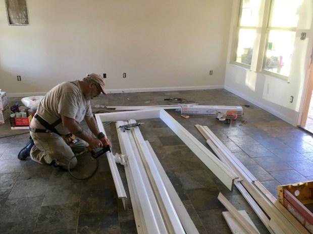 (Other) Tom nailing a door frame together