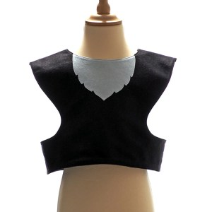 Front of the black cat tabard. Tabard is black with a white bib at the centre front.