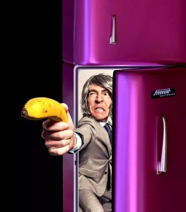 """Business man holding banana gun asks you the question, """"Why Does Hot Sauce Need to Be Refrigerated?"""""""