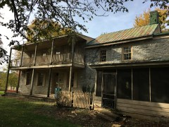 The prior screened-in porch was non-historic and dilapidated beyond repair. It had to go.