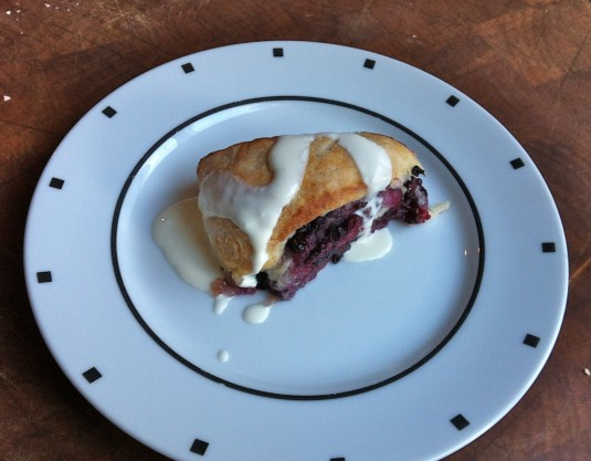 single serving of blackberry roll with creme fraiche