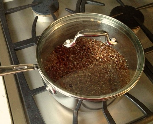 red quinoa in saucepan done