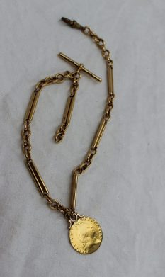 An 18ct yellow gold Albert chain with rectangular and oval links, together with a George III shield back guinea, total weight approximately 64.9 grams. Sold for £880 at Anthemion Auctions