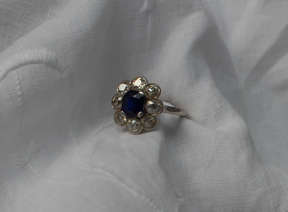 A sapphire and diamond cluster ring. Sold at Anthemion Auctions for £1,250