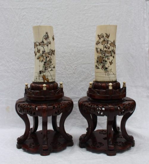 A pair of Japanese shibayama ivory tusks early 20th century each decorated in mother of pearl with trailing flowers, branches, birds and insects both set on hardwood stands 44cm high (the tusks measuring 20cm). Sold for £650 at Anthemion Auctions