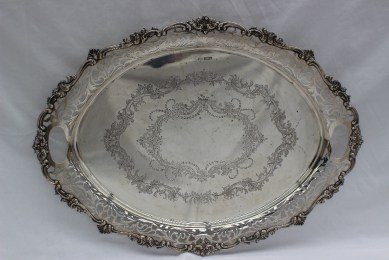A George V silver twin handled tray, with a pierced border, the plate engraved with leaves and swags, Sheffield, 1917.. Sold at Anthemion Auctions for £1,050