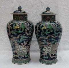 A pair of Chinese porcelain baluster vases and covers with polychrome decoration of butterflies and phoenix to a blue and turquoise ground, 47cm high . Sold for £620 at Anthemion Auctions