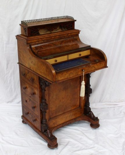 A Victorian walnut piano topped Davenport. Sold for £1,350 at Anthemion Auctions