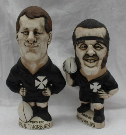 A John Hughes pottery Grogg of Kevin Phillips in a Neath R.F.C. jersey with the No.2 to the reverse, 23cm high together with another of Paul Thorburn in a Neath R.F.C Jersey with the No. 15 on the reverse. Sold at Anthemion Auctions for £880