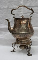 A Victorian silver kettle on stand of large proportions with a scrolling handle. Sold for £720 at Anthemion Auctions