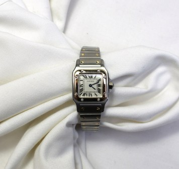 A lady's Santos De Cartier 18ct gold and steel wristwatch. Sold for £1,150 at Anthemion Auctions