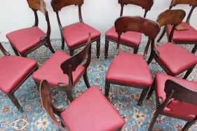 A set of ten early 19th century mahogany dining chairs, with a shaped bar back and drop in seat on carved tapering front legs and turned feet (10). Sold for £920 at Anthemion Auctions