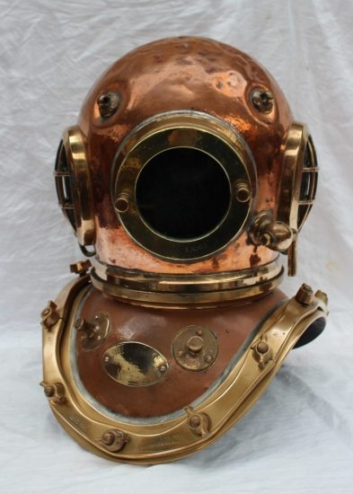 A Siebe Gorman & Co Ltd twelve bolt copper divers helmet. Sold for £3,000 at Anthemion Auctions