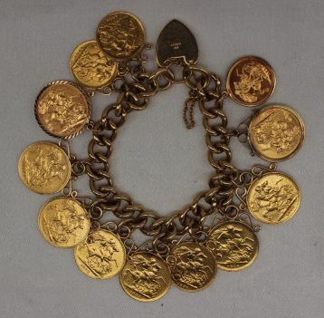 A 9ct yellow gold bracelet attached with nine sovereigns and three half sovereigns, Sold for £1,850 at Anthemion Auctions