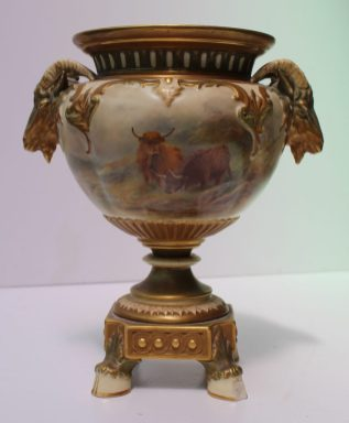 A Royal Worcester porcelain twin handled vase, with a flared rim, with twin rams head handles, the body painted with highland cattle signed H Stinton. Sold for £620 at Anthemion Auctions