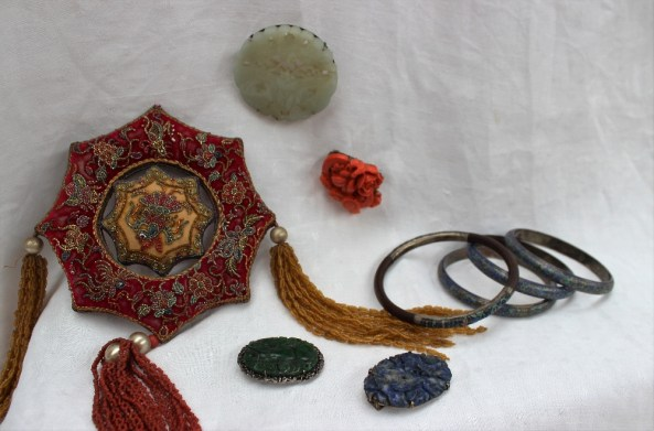 A set of three champleve enamel bangles together with another bangle, a jade brooch, coral brooch, other brooches and a beadwork panel. Sold for £620 at Anthemion Auctions