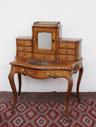 A 19th century French walnut bonheur du jour, the raised superstructure with a mirrored door and drawers, the base with a single drawer on ormolu mounted cabriole legs. Sold for £600 at Anthemion Auctions