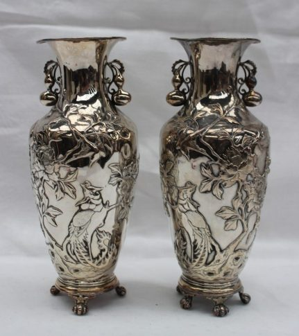 A pair of Chinese white metal vases with gourd handles. Sold for £900 at Anthemion Auctions