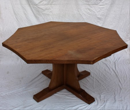 "A Robert Thompson of Kilburn ""Mouseman"" octagonal topped dining table with trademark mouse. Sold for £680 at Anthemion Auctions"