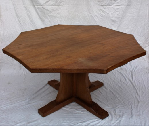 """A Robert Thompson of Kilburn """"Mouseman"""" octagonal topped dining table with trademark mouse. Sold for £680 at Anthemion Auctions"""