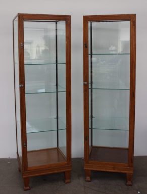 A pair of oak framed tower display cabinets. Sold for £680 at Anthemion Auctions