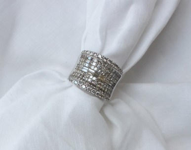 A diamond set dress ring, set with two rows of brilliant cut diamonds, six rows of princess cut diamonds and two rows of baguette cut diamonds to a white metal setting and shank marked K18, ring size P 1/2. Sold for £1,500 at Anthemion Auctions