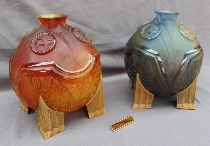 "A pair of Daum ""Salammbo"" vases for night and day in moulded thick glass in purple and amber. Sold for £4,500 at Anthemion Auctions"