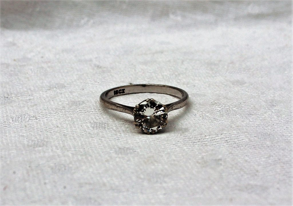A solitaire diamond ring the brilliant cut diamond approximately 1.5 carats to a claw mount and white metal shank marked 18ct. Sold for £2,550 at Anthemion Auctions