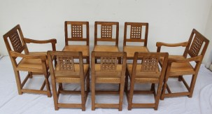 "Robert Thompson of Kilburn, ""Mouseman"" - a set of eight light oak dining chairs, each carved with the trademark mouse. Sold for £2,400 at Anthemion Auctions"