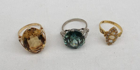 An opal and diamond dress ring, a 9ct yellow gold dress ring, and a green stone and diamond dress ring