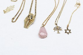 A rose quartz pendant on a 14ct yellow gold chain together with a 14ct yellow gold Egyptian pendant and chain, and other 14ct yellow gold pendants and chains, approximately 128 grams. Sold for £1,100 at Anthemion Auctions