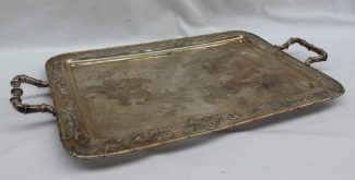 A Chinese white metal twin handled tray, the edge and handles in faux bamboo. Sold for £1,500 at Anthemion Auctions