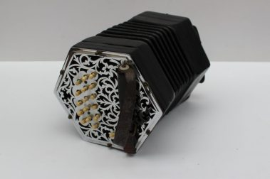 A C jeffries concertina. Sold for £3,400 at Anthemion Auctions